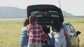 Asian women getting ready for camping in nature at summer. video