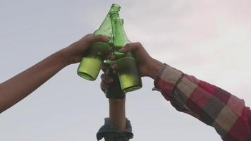 Asian women camping in nature having fun together drinking beer video