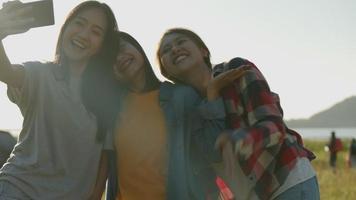 Asian women taking selfies having fun together at summer travel video