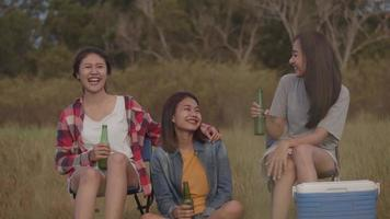 Young women drinking beer while camping video