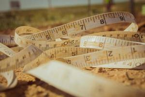 Measuring tape placed on the ground at a construction site photo