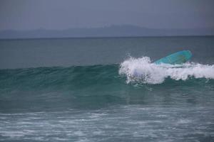 reverse surfboard in the ocean photo