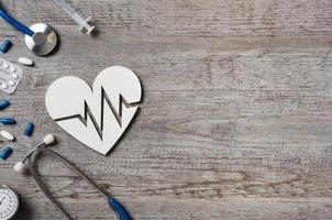 Heart and cardiogram sign photo