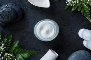 Moisturizer jar on natural background photo