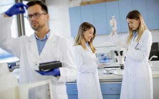 Female researchers in white lab coat working in the laboratory photo