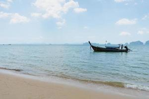 Landscape of long tail boat on the blue sea with white sand in summer photo