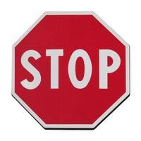 señal de stop aislado sobre blanco foto