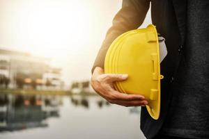 Worker Architecture Engineer hold hard hat helmet safety  for construction photo