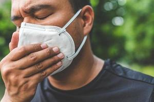 Man wearing a mask on the street. Protection against virus photo