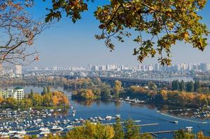 Panoramic view of district Podil and the Dnipro river in Kyiv at autumn photo