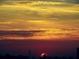 Sun rising over Kyiv city skyline, Ukraine photo