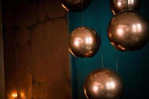 Soft focus sphere bronze lamps with dark blue backdrop photo
