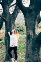 pretty girl in a park with big trees photo