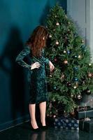 Beautiful woman decorating Christmas tree photo