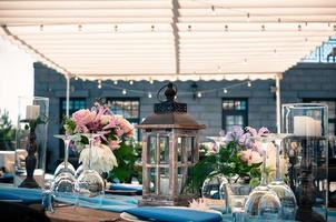 Wedding or event decoration table setup, summer outdoors photo
