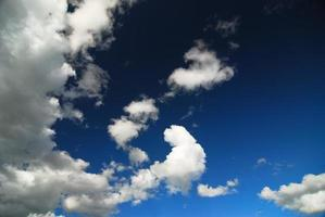 white fluffy clouds with background blue sky photo