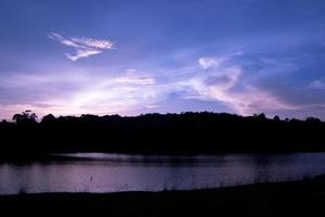 Beautiful sky landscape with sunset over river bank photo