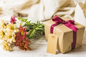present box with brown tag flower bunch table photo