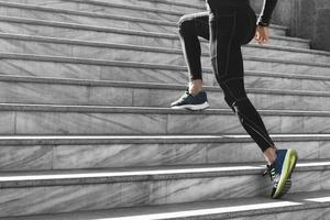 side view man athletic wear exercising stairs outdoors photo