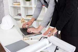 sales agent using laptop photo