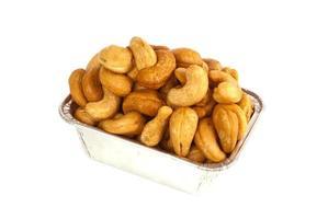Roasted cashews in aluminum foil tray photo