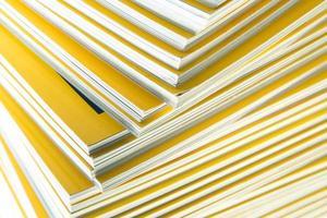 Stack of yellow monthly magazine photo