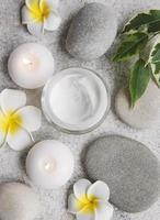 Spa treatment with massage stones and moisturizing cream photo