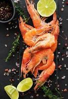 Shrimps or prawns served with lemon photo