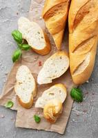 Sliced fresh crusty baguette photo