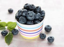 Blueberries on tile background photo