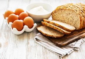 Bread, eggs and flour photo