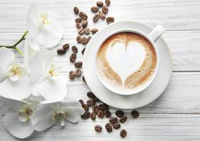 A cup of coffee with heart pattern photo