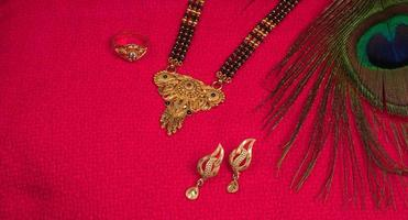 Mangalsutra or Golden Necklace to wear by a married hindu women, arranged with beautiful backgrond. Indian Traditional Jewellery. photo
