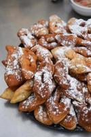 delicious buns - pretzels sprinkled with powdered photo