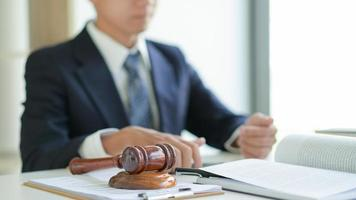 The lawyer provides legal documents for his clients. photo