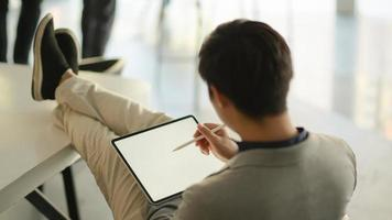 Business people feel comfortable using tablet blank screen. photo