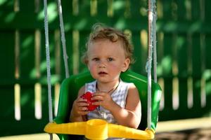 Beautiful baby boy with child swing posing photographer photo