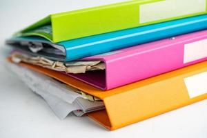 File Folder Binder stack of multi color on table in business office. photo