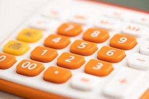 Number pad on orange color calculator for account finance in office. photo