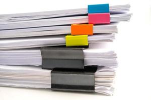 Stack of report paper files in business office clips. photo