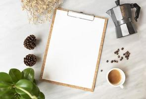 Menu paper mockup with coffee cup in restaurant for input design list text. photo
