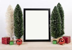 Christmas holiday greeting frame design mockup with decoration on wood table. photo