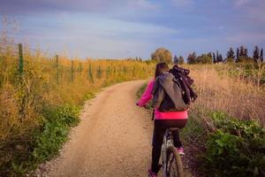 Woman riding a bicycle in the countryside photo