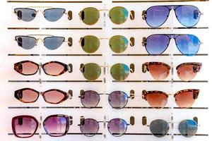 Stand with many sunglasses in a store of optics photo