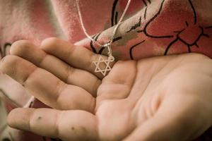 Necklace with the Star of David on a girl's hand photo