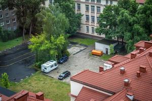 Aerial view of cars and recreational vehicle parking in an urban area at Warsaw in Poland photo