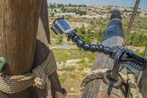 Action camera on stick on climbing tower photo