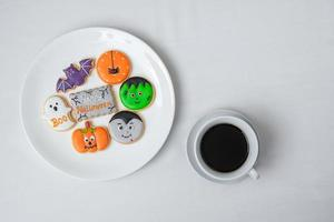 hot coffee cup with funny Halloween Cookies. Happy Halloween day, Trick or Threat, Hello October, fall autumn, Traditional, party and holiday concept photo