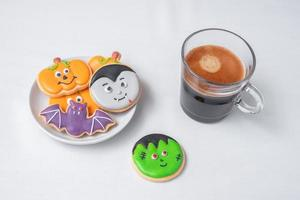 hot espresso coffee  or chocolate cup with funny Halloween Cookies. Happy Halloween day, Trick or Threat, Hello October, fall autumn, Traditional, party and holiday concept photo