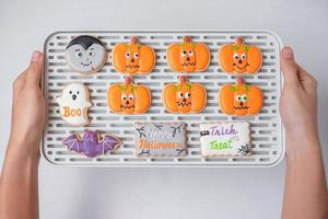 Halloween funny Cookies on tray. Trick or Threat, Happy Halloween, Hello October, fall autumn, Festive, party and holiday concept photo